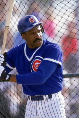 1991:  Andre Dawson #8 of the Chicago Cubs stand ready inside the batting cage during practice in 1991. (Photo by Otto Greule Jr/Getty Images)