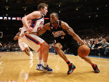 NEW YORK - JANUARY 17: Andre Iguodala #9 of the Philadelphia 76ers drives to the basket against David Lee #42 of the New York Knicks on January 17, 2009 at Madison Square Garden in New York City, New York. NOTE TO USER: User expressly acknowledges and agr