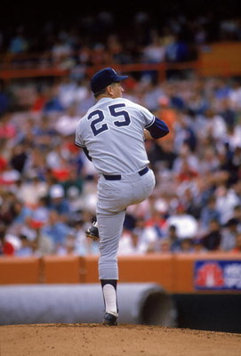 ANAHEIM, CA - 1989:  Tommy John #25 of the New York Yankees pitches during a 1989 season game against the California Angels at Anaheim Stadium in Anaheim, California.  (Photo by Stephen Dunn/Getty Images)