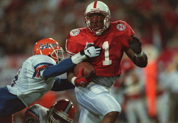2 Jan 1996:  Running back Lawrence Phillips #1 of the Nebraska Cornhuskers breaks throught the attempted arm tackle by an unidentified Florida Gators defender during the Cornhuskers 62-54 victory over the Gators in the Fiesta Bowl at Sun Devil Stadium in