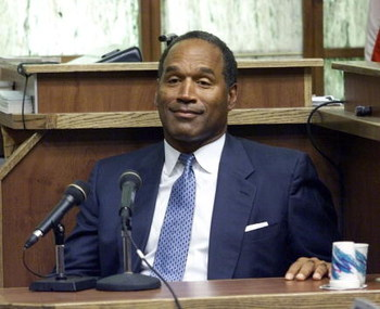 397272 06: (FILE PHOTO) Former NFL star and actor O.J. Simpson testifies in Miami-Dade County Court during his 'road rage' trial October 23, 2001 in Miami, Florida. U.S. Federal agents searched Simpson's home near Miami December 4, 2001 during an investig