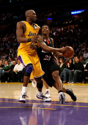 LOS ANGELES, CA - MARCH 17:  Louis Williams #23 of the Philadelphia 76er drives into the lane against Lamar Odom #7 of the Los Angeles Lakers on March 17, 2009 at Staples Center in Los Angeles, California.  The 76ers won 94-93.   NOTE TO USER: User expres