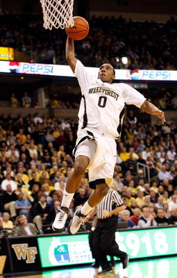 WINSTON-SALEM, NC - FEBRUARY 18:  Jeff Teague #0 of the Wake Forest Demon Deacons goes up for a dunk against the Georgia Tech Yellow Jackets during their game at Lawrence Joel Coliseum on February 18, 2009 in Winston-Salem, North Carolina.  (Photo by Stre