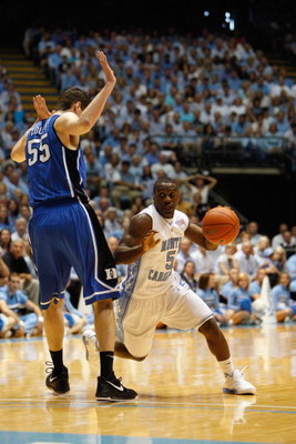 CHAPEL HILL, NC - MARCH 8:  Ty Lawson #5 of the North Carolina Tar Heels dribbles against Brian Zoubek #55 of the Duke Blue Devils during the game at the Dean E. Smith Center on March 8, 2009 in Chapel Hill, North Carolina. (Photo by Streeter Lecka/Getty