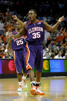 CHARLOTTE, NC - MARCH 15:  Trevor Booker #35 of the Clemson Tigers reacts along with teammate Cliff Hammonds #25 in the second half against the Duke Blue Devils during the semifinals of the 2008 Men's ACC Basketball Tournament at Bobcats Arena on March 15