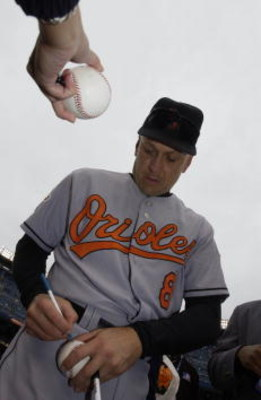 30 Sep 2001: Cal Ripken Jr. of the Baltimore Orioles signs autographs before his final game against the New York Yankees at Yankee Stadium in the Bronx, New York. DIGITAL IMAGE. Mandatory Credit: Ezra Shaw/Allsport
