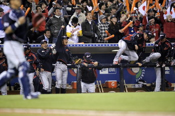 SAN DIEGO - MARCH 18: The Japanese bench celebrates after defeating Cuba 5-0 during the 2009 World Baseball Classic Round 2 Pool 1 Game 5 on March 18, 2009 at Petco Park in San Diego, California.  (Photo by Kevork Djansezian/Getty Images)