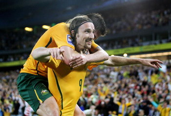 SYDNEY, AUSTRALIA - APRIL 01:  Harry Kewell (L) of Australia celebrates with Joshua Kennedy after Kennedy scored a goal during the 2010 FIFA World Cup qualifying match between the Australian Socceroos and Uzbekistan at ANZ Stadium on April 1, 2009 in Sydn