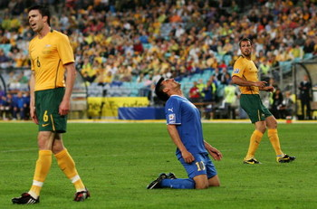 SYDNEY, AUSTRALIA - APRIL 01:  Farhod Tadjiyev of Uzbekistan shows emotion after a missed opportunity as Michael Beauchamp (L) and Lucas Neill (R) of Australia look on during the 2010 FIFA World Cup qualifying match between Australia and Uzbekistan at ANZ