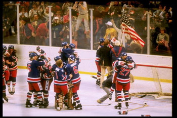 24 Feb 1980: Team USA celebrate after defeating Finland to win the gold medal game of the Winter Olympics in Lake Placid, New York. The USA won the game 4-2 and the gold medal.