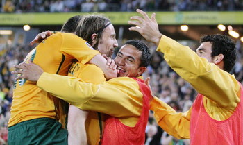 SYDNEY, AUSTRALIA - APRIL 01: Harry Kewell (L) and Tim Cahill (2nd R) of Australia embrace Joshua Kennedy (2nd L) after Kennedy scored a goal during the 2010 FIFA World Cup qualifying match between the Australian Socceroos and Uzbekistan at ANZ Stadium on