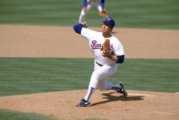 ARLINGTON, TX - 1990:  Nolan Ryan #34 of the Texas Rangers pitches during the 1990 season at Arlington Stadium in Arlington, Texas.  (Photo by Rick Stewart/Getty Images)