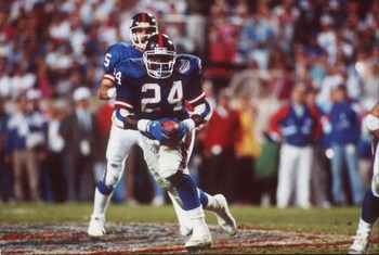 1991:  Running back Ottis Anderson #24 of the New York Giants receives the hand off from quarterback Jeff Hostetler #15 during the Giants 20-19 win over the Buffalo Bills during SuperBowl XXV at Tampa Stadium in Tampa, Florida.  (Photo by Rick Stewart/Get