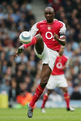 MANCHESTER, ENGLAND - SEPTEMBER 25:  Patrick Vieira of Arsenal controls the ball during the Barclays Premiership match between Manchester City and Arsenal at the City of Manchester Stadium on September 25, 2004 in Manchester, England.  (Photo by Shaun Bot