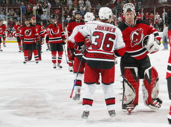 NEWARK, NJ - APRIL 28:  Jussi Jokinen #36 of the Carolina Hurricanes is congratulated by Martin Brodeur #30 of the New Jersey Devils after the Hurricanes defeats the Devils 4-3 in Game Seven of the Eastern Conference Quarterfinal Round of the 2009 Stanley