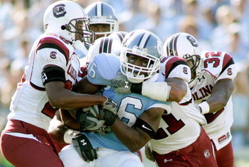 CHAPEL HILL, NC - OCTOBER 13:  Anthony Elzy #6 of the North Carolina Tar Heels is gang-tackled by the South Carolina Gamecocks defense in the first quarter at Kenan Stadium October 13, 2007 in Chapel Hill, North Carolina.  (Photo by Grant Halverson/Getty