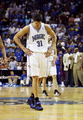 ORLANDO, FL - APRIL 28:  Darko Milicic #31 of the Orlando Magic walks back toward the Magic bench after comitting a turn-over late in the game against the Detroit Pistons in Game Four of the Eastern Conference Quarterfinals during the 2007 NBA Playoffs at