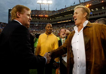 TAMPA, FL - FEBRUARY 01:  NFL Commissioner Roger Goodell (L) greets NFL Hall of Famer John Elway on the field prior to Super Bowl XLIII between the Arizona Cardinals and the Pittsburgh Steelers on February 1, 2009 at Raymond James Stadium in Tampa, Florid