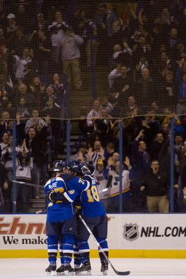 ST. LOUIS, MO. - MARCH 12: The St. Louis Blues celebrate an empty-net goal against the San Jose Sharks at the Scottrade Center on March 12, 2009 in St. Louis, Missouri.  (Dilip Vishwanat/Getty Images)