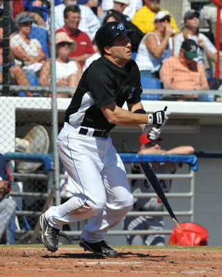 DUNEDIN, FL - MARCH 4: Infielder John McDonald #6 of the Toronto Blue Jays breaks a bat against the USA World Baseball team in an exhibition game on March 4, 2009 at Dunedin Stadium in Dunedin, Florida.  (Photo by Al Messerschmidt/Getty Images)