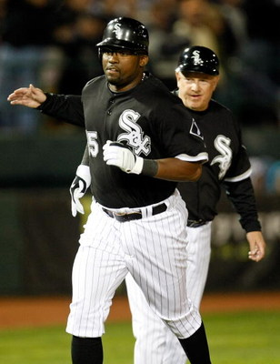 LAS VEGAS - MARCH 04:  Wilson Betemit #15 of the Chicago White Sox is congratulated by third base coach Jeff Cox #8 after Betemit hit a two-run home run against the Chicago Cubs during an exhibition game at Cashman Field March 4, 2009 in Las Vegas, Nevada