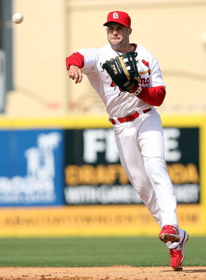 JUPITER, FL - MARCH 02:  Second baseman Skip Schumaker #55 of the St. Louis Cardinals tries to throw out Evan Longoria #3 of the Tampa Bay Rays during a spring training game at Roger Dean Stadium on March 2, 2009 in Jupiter, Florida. The Rays defeated the