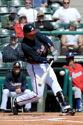 KISSIMMEE, FL - MARCH 3:  Omar Infante #4 of the Atlanta Braves hits during an exhibition game against Panama at Champion Stadium March 3, 2009 in Kissimmee, Florida.  (Photo by Sam Greenwood/Getty Images)