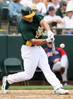 TEMPE, AZ - MARCH 08:  Matt Holliday #5 of the Oakland Athletics bats against the Cleveland Indians during the spring training game at Phoenix Municipal Stadium on March 8, 2009 in Tempe, Arizona. The A's defeated the Indians 8-5.  (Photo by Christian Pet