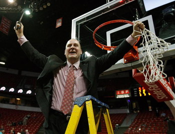 LAS VEGAS - MARCH 14:  Head coach Jim Boylen of the Utah Utes reacts after cutting down the net after defeating the San Diego State Aztecs 52-50 during the championship game of the Conoco Mountain West Conference tournament at the Thomas & Mack Center Mar