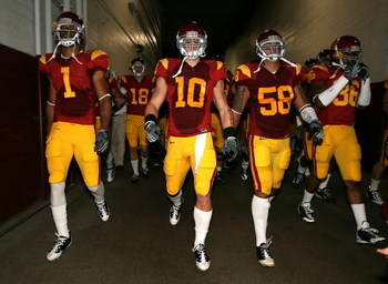 LOS ANGELES, CA - NOVEMBER 29:  (L-R) Patrick Turner #1, Brian Cushing #10 and Rey Maualuga #58 of the USC Trojans walk out to the field before the game against the Notre Dame Fighting Irish at Los Angeles Memorial Coliseum on November 29, 2008 in Los Ang
