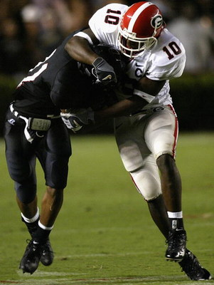 COLUMBIA, SC - SEPTEMBER 11:  Thomas Davis #10 of the Georgia Bulldogs tackles Demetris Summers #31 of the South Carolina Gamecocks during their game at Williams-Brice Stadium on September 11, 2004 in Columbia, South Carolina. (Photo by Streeter Lecka/Get