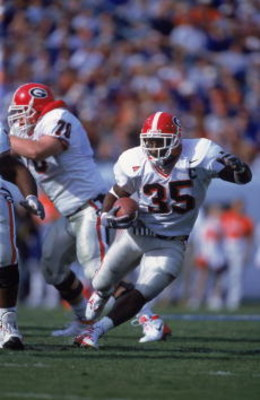27 Oct 2001:   Verron Haynes #35 of the Georgia Bulldogs runs with the ball assisted by teammate Kevin Breedlove #70 during the game against the Florida Gators at the Alltel Stadium in Jacksonville, Florida.  The Gators defeated the Bulldogs 24-10. Mandat