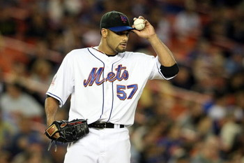 NEW YORK - SEPTEMBER 23:  Johan Santana #57 of the New York Mets adjusts his hat after the third inning against the Chicago Cubs during their game at Shea Stadium September 23, 2008 in the Flushing neighborhood of the Queens borough of New York City.  (Ph