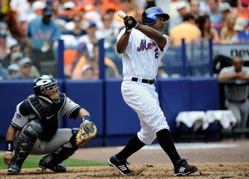NEW YORK - JUNE 29: Carlos Delgado #21 of the New York Mets hits a solo home run in the third inning against the New York Yankees at Shea Stadium on June 29, 2008 in the Flushing neighborhood of the Queens borough of New York City.  (Photo by Jeff Zelevan