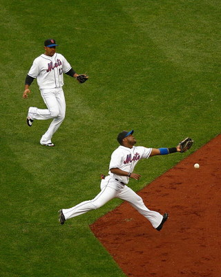 NEW YORK - APRIL 03: Second baseman Luis Castillo of the New York Mets comes up short on a fly ball hit by Dustin Pedroia of the Boston Red Sox on April 3, 2009 at Citi Field in the Flushing neighborhood of the Queens borough of New York City. The game ma