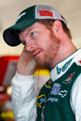 FORT WORTH, TX - APRIL 03:  Dale Earnhardt Jr., driver of the #88 National Guard/AMP Energy Chevrolet, stands in the garage area during practice for the NASCAR Sprint Cup Series Samsung 500 at Texas Motor Speedway on April 3, 2009 in Fort Worth, Texas.  (