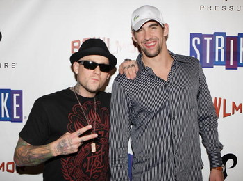 NEW YORK - OCTOBER 07:  Olympic gold medalist Michael Phelps and Benji Madden of the rock band Good Charlotte pose for a photo on the red carpet at Bowlmor Lanes 70th Anniversary party on October 7, 2008 at Bowlmor Lanes in New York City.  (Photo by Mike