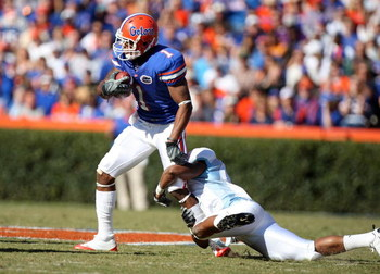 GAINESVILLE, FL - NOVEMBER 22:  Percy Harvin #1 of the Florida Gators catches a pass against Demetrius Jackson #1 of the Citadel Bulldogs during the game at Ben Hill Griffin Stadium on November 22, 2008 in Gainesville, Florida.  (Photo by Sam Greenwood/Ge