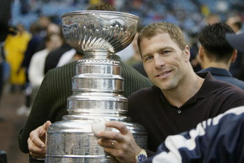 BRONX, NY - JUNE 13:  Defenseman Scott Stevens #4 of the New Jersey Devils poses for a picture with the Stanley Cup before the interleague game between the New York Yankees and the St. Louis Cardinals at Yankee Stadium on June 13, 2003 in the Bronx, New Y