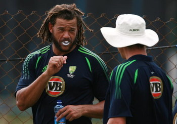 ST. GEORGES, GRENADA - JUNE 26:  :  Andrew Symonds of Australia talks with a teammate during a training day at National Stadium in advance of their One-Day International match against West Indies on June 26, 2008 in St. Georges, Grenada.  (Photo by Doug B