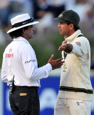CAPE TOWN, SOUTH AFRICA - MARCH 20:  Ricky Ponting of Australia speaks umpire Asad Rauf after a leg bye was changed to a run from the bat giving Jacques Kallis of South Africa his century during day two of the Third Test between South Africa and Australia