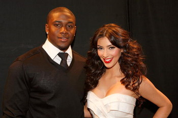NEW YORK - FEBRUARY 16:  TV personality Kim Kardashian (right) and Reggie Bush of the New Orleans Saints pose backstage during Mercedes-Benz Fall 2009 Fashion Week at Bryant Park on February 16, 2009 in New York City.  (Photo by Thos Robinson/Getty Images