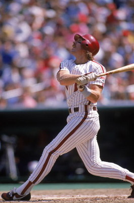PHILADELPHIA - 1989:  Mike Schmidt #20 of the Philadelphia Phillies watches the flight of the ball during a 1989 season game at Veterans Stadium in Philadelphia, Pennsylvania. (Photo by Rick Stewart/Getty Images)