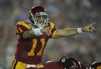 PASADENA, CA - JANUARY 04:  Quarterback Matt Leinart #11 of the USC Trojans call a play in the first quarter against the Texas Longhorns during the BCS National Championship Rose Bowl Game on January 4, 2006 in Pasadena, California.  (Photo by Stephen Dun