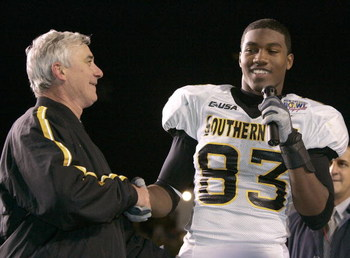 LAFAYETTE, LA - DECEMBER 20: Head coach Jeff Bower (L) congratulates New Orleans Bowl MVP Shawn Nelson #83 (R) of Southern Miss after defeating Arkansas State 31-19 after The New Orleans Bowl on December 20, 2005 at Cajun Field in Lafayette, Louisiana.  T