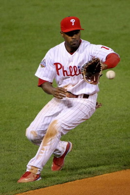 PHILADELPHIA - OCTOBER 26:  Jimmy Rollins #11 of the Philadelphia Phillies fields a ball against the Tampa Bay Rays during game four of the 2008 MLB World Series on October 26, 2008 at Citizens Bank Park in Philadelphia, Pennsylvania.  (Photo by Doug Pens