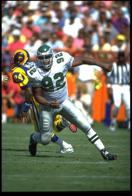 23 SEP 1990:  PHILADELPHIA EAGLES DEFENSIVE END REGGIE WHITE  IS IN PURSUIT OF THE LOS ANGELES RAMS QUARTERBACK DURING THE EAGLES 27-21 VICTORY OVER THE RAMS AT ANAHEIM STADIUM IN ANAHEIM, CALIFORNIA.