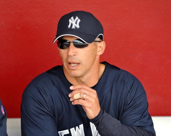 SARASOTA, FL - MARCH 1:  Manager Joe Girardi #27 of the New York Yankees watches warm ups against the Cincinnati Reds March 1, 2009 at Ed Smith Stadium in Sarasota, Florida.  (Photo by Al Messerschmidt/Getty Images)