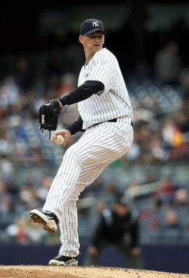 NEW YORK - APRIL 04:  A.J. Burnett #34 of the New York Yankees pitches against the Chicago Cubs during their game on April 4, 2009 at Yankee Stadium in the Bronx borough of New York City.  (Photo by Nick Laham/Getty Images)
