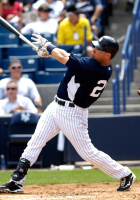 TAMPA, FL - APRIL 01:  Infielder Mark Teixeira #25 of the New York Yankees homers against the Philadelphia Phillies at George Steinbrenner Field April 1, 2009 in Tampa, Florida.  (Photo by Al Messerschmidt/Getty Images)